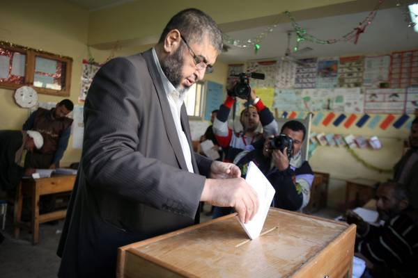 Egyptian senior member of the Muslim Brotherhood Khairat al-Shater casts his vote during the first round of Egypt's parliamentary elections