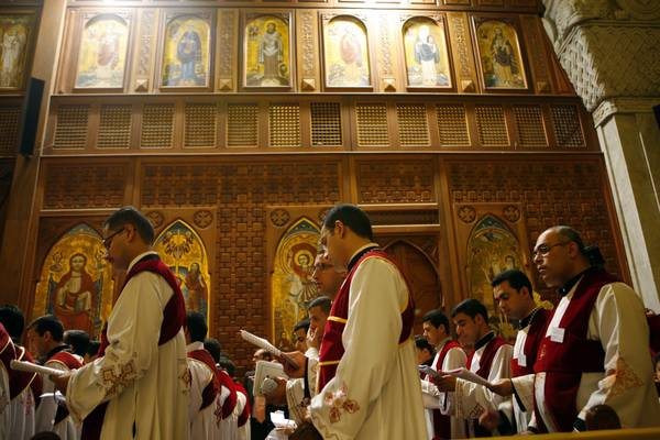 Egyptian Christians take part in a mass at the Coptic Cathedral of Saint Marcos in Cairo