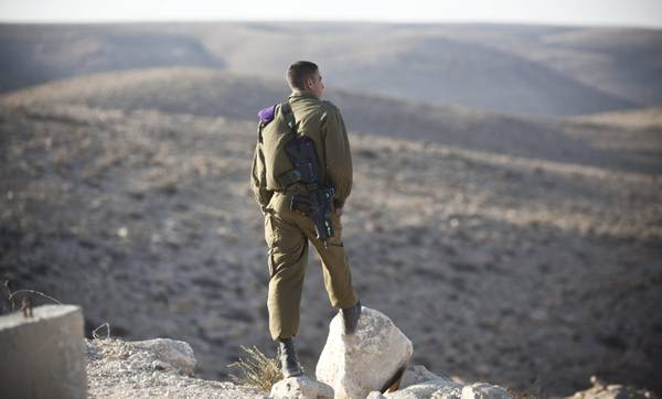 An Israeli solders stands on a vantage point outside the Sagi Mount base, southern  Israel