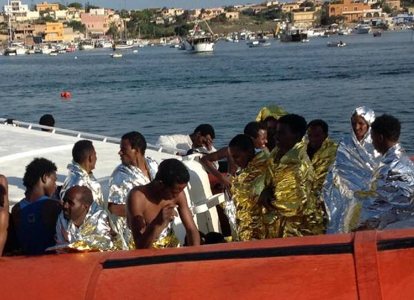 Migrants being rescued after wreck near Lampedusa