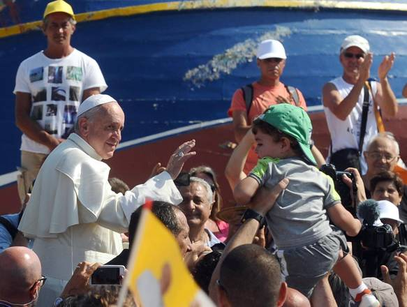 Pope Francis blesses faithfull during his visit in Lampedusa Island, south Italy, 08 July 2013.