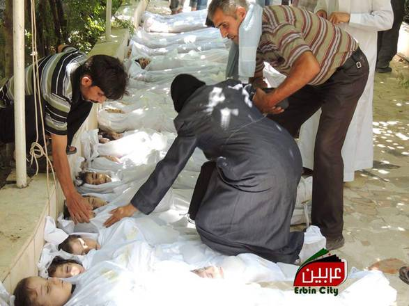 Bodies of Syrian children after a poisonous gas attack on August 21, 2013 in Damascus suburbs