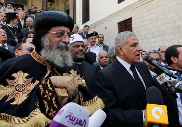Egyptian Prime Minister Ibrahim Mahlab (R) and Pope Tawadros II (L) of Alexandria at the ceremony for the recent reopening of the Hanging Church, in Old Cairo