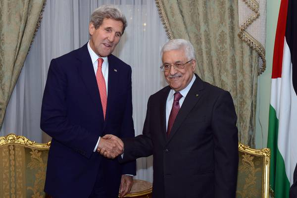 Palestinian President Mahmoud  Abbas (R) as he meets with US Secretary State John Kerry (L), on the sidelines of the Gaza Donor  Conference in Cairo, Egypt, 12 October 2014