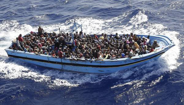 A boat with migrants in southern Mediterranean Sea