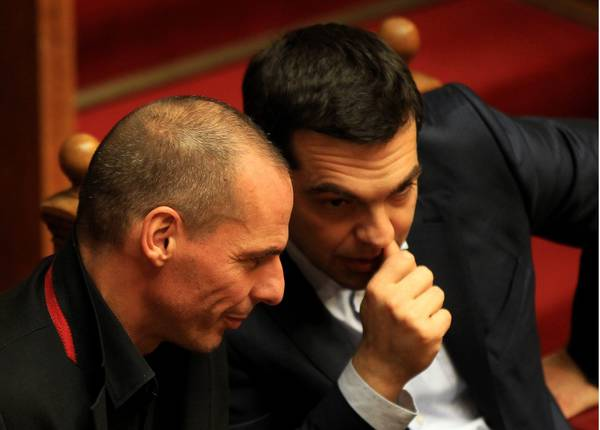 Greek Prime Minister Alexis Tsipras (R) talks with Finance Minister Yanis Varoufakis (L)