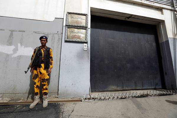 A Yemeni soldier stands guard outside the Egyptian embassy few hours after it was shut down, in Sanaa, Yemen