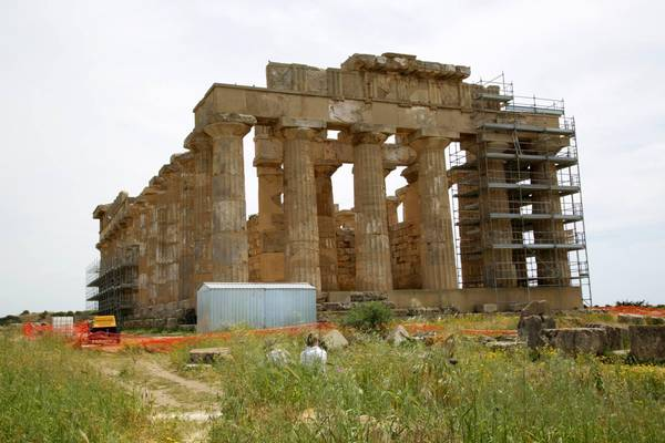 Temples are 'caged' against the ravages of time by scaffolding in the 270-hectare Selinunte archaeological park near Trapani