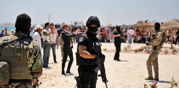 Members of the Tunisian Security Services at the site of a terror attack on a beach outside the Imperial Marhaba Hotel, al-Sousse