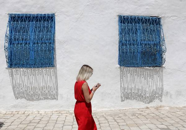 A tourist in Sidi Bou Said in Tunisia