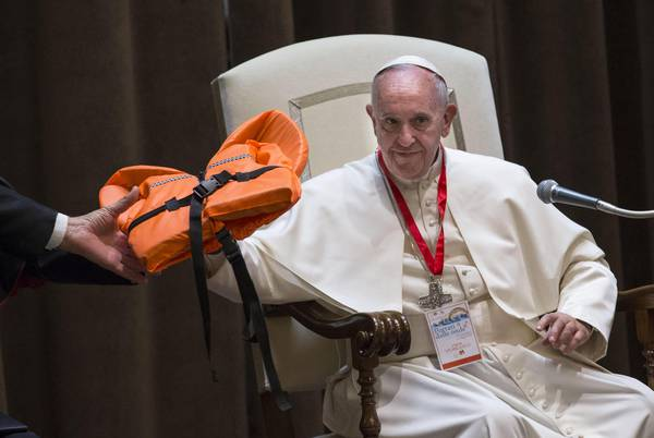 'Migrants not a threat, end hostility', says Pope Francis