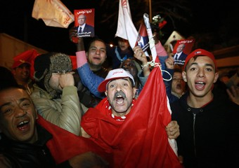 Supporters of the Presidential candidate Beji Caid Essebsi shout slogans celebrate the first results of the Tunisian electi