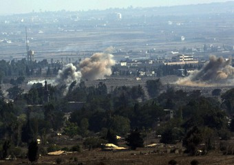 Smoke in the Syrian town of Quneitra during fighting between Syrian army and rebels, as  seen from the Israel side of the border