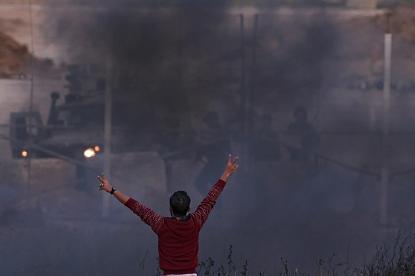 Palestinian protesters clash with Israeli troops along the Gaza Strip border