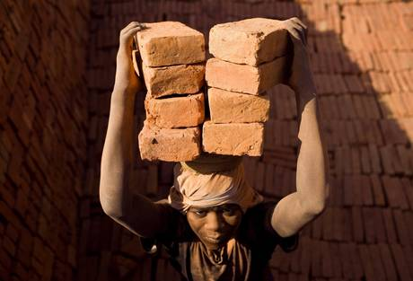 Indian migrant workers working at a brick factory in Lalitpur