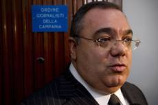 Ex-fugitive Berlusconi associate faces extortion charges
